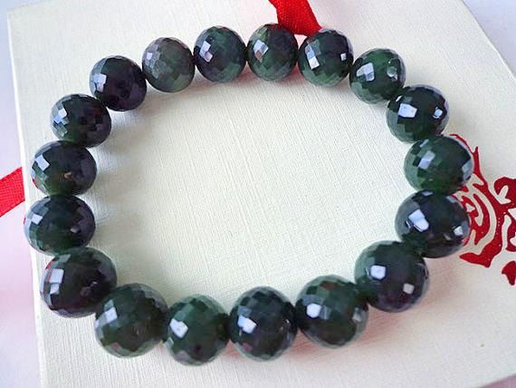 10 mm Nephrite jade faceted round bead bracelet. S442