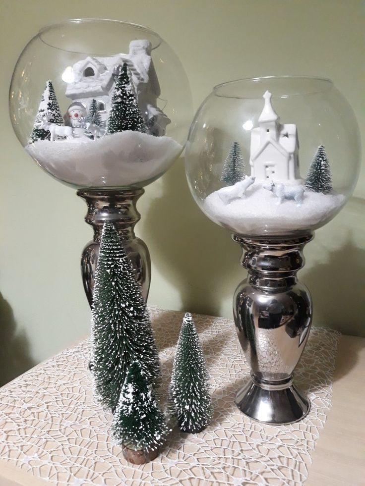 Winter wonderland centrepiece.  Christmas village in a big round vase upon a silver candle holder.