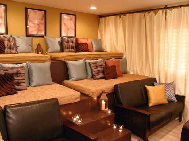 home theater in the basement...single beds, build in levels. And great for kids sleep overs - fun hangout.