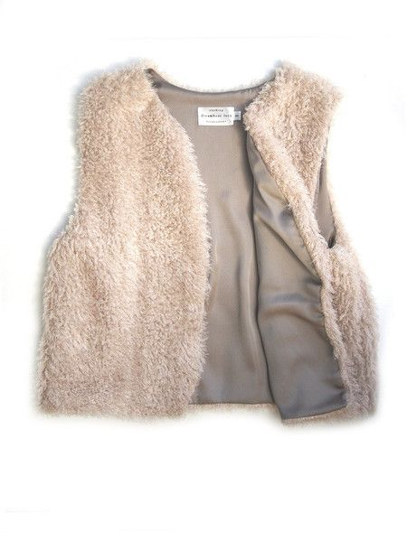 The Fancy Fur Lenora Vest in Champagne - A fully lined, crop-style vest made of 100% faux fur. Super soft and the perfect addition to your closet. Made to go with jeans, dresses, t-shirts and almost anything else. MATERIALS Polyester. Made in Canada. Hand wash cold, lay flat to dry. SIZING One size fits most. Shipping: Ships within 2-4 days from the designer.
