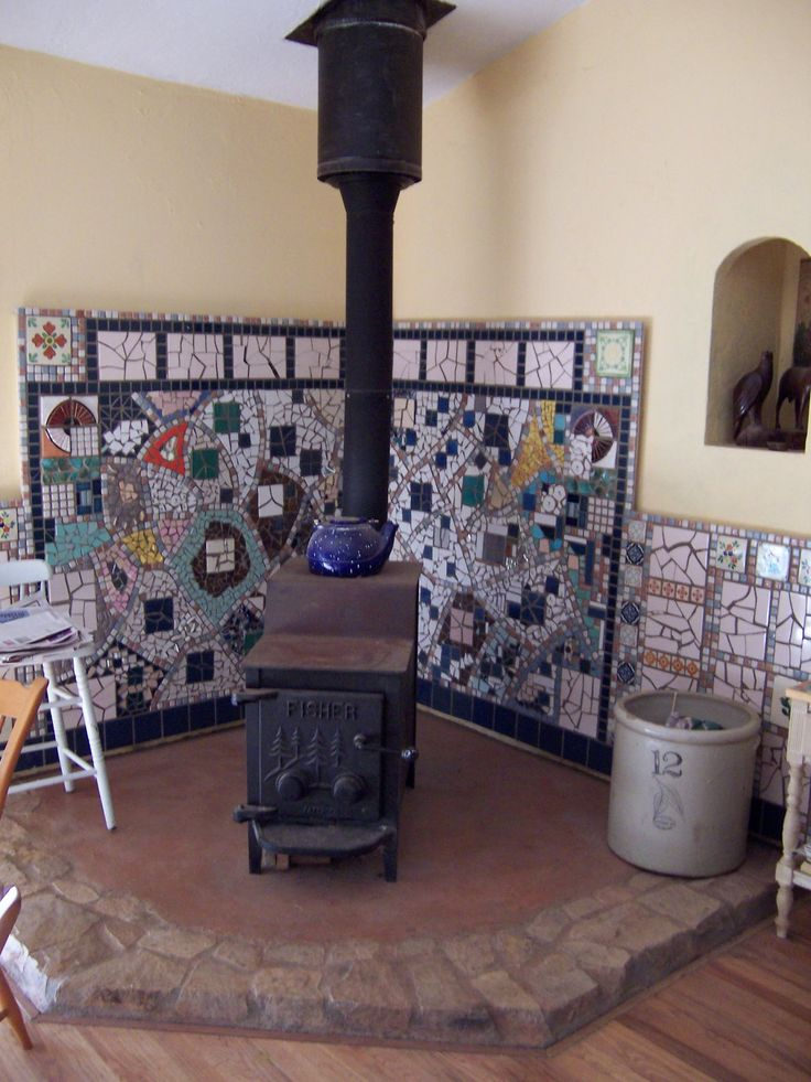 Build Wood Stove Heat Shield | It took me 8 days to do this tiling, - Wood Stove Surround Pinterest'te Hakkında 1000'den Fazla Fikir