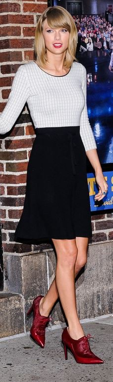Who made Taylor Swift's black bow skirt and white check print shirt? Shirt and skirt – Oscar de la Renta
