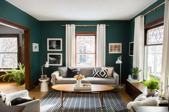 bold emerald green wall paint with mid century modern accents