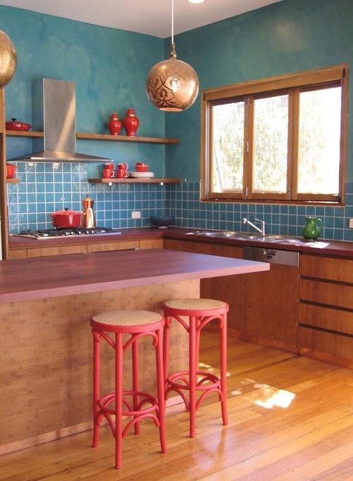 Scandinavian kitchen design in wood & teal with red accents More
