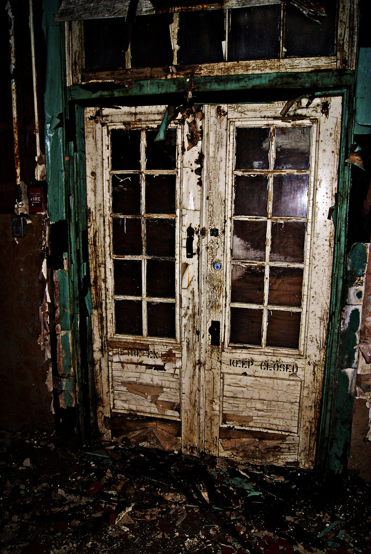 Rotting doors in decrepit building