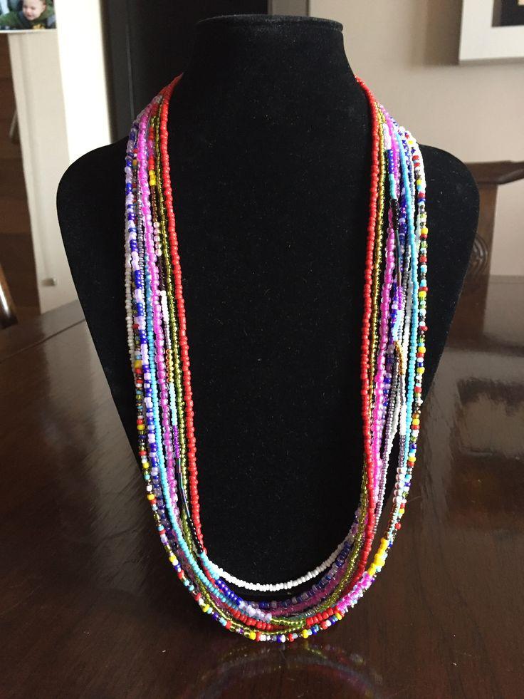 Multi strand, multi coloured seed bead necklace