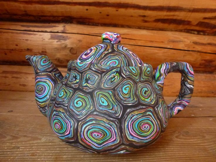 Tea pot made of polymer clay on porcelain
