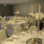 Silver plated candelabras, feathers, pearls