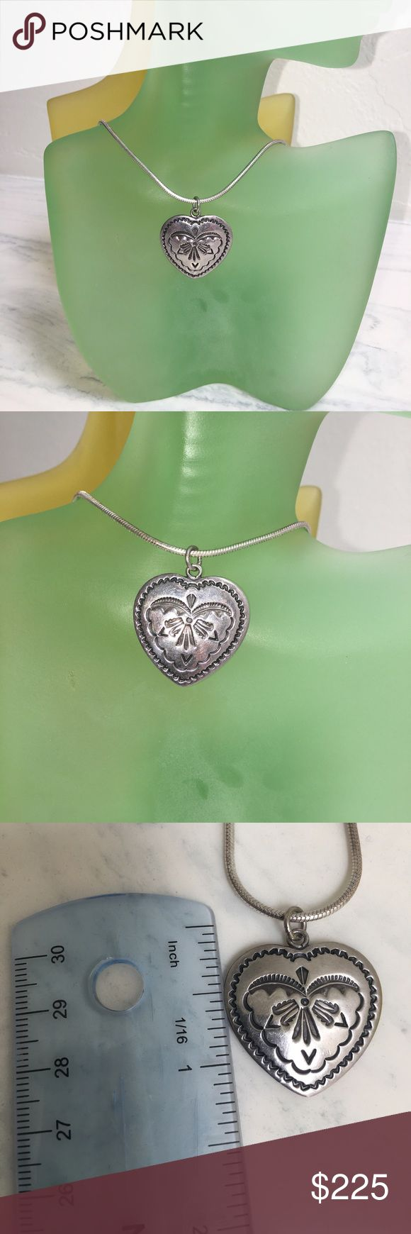 """Handmade Navajo Sterling Silver Heart Necklace I'm selling a fabulous Handmade Native American Indian """"Navajo"""" Sterling Silver Heart Necklace. It's stamped Sterling Silver and the Navajo Artist name is also stamped into the silver. The Sterling Silver Serpentine chain measures 18"""".  I LOVE the hand stamp work on the front of the silver heart, its been very well done. ❣️💕♥️😘🤗 Jewelry Necklaces"""