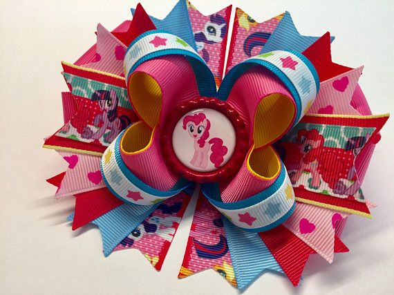 My Little Pony PINKIE PIE Boutique Stacked Hair Bow Bow measured Approximately W5..5x L5.0 x H2.0 at the widest point. Made of high quality Grosgrain Ribbon. Ends are Heat Treated to prevent fraying. Choice of Clip ....60mm Partially Lined French Style Barrette. 55mm Partially Lined