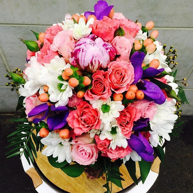 A bouquet including Roses, Peonies, Hypericum, Chrysanthemum, and Orchids