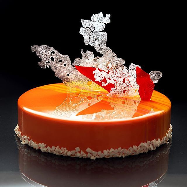 """Cake with exotic fruit"" for my first masterclass. Crispy base with nuts, almond cake, mango mousse and mango-passion fruit compote, mirror glaze and decoration of isomalt."