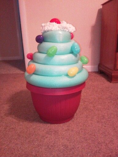 Giant cupcake decoration! Plastic, flower pot, two pool noodles, Easter eggs, and spray foam insulation!!