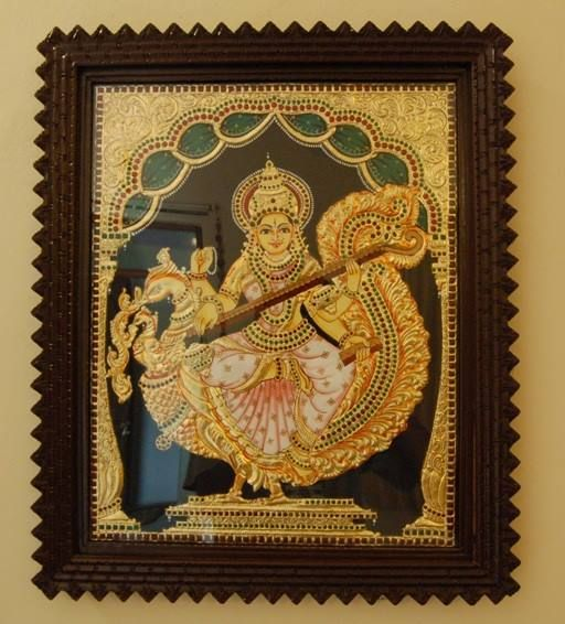 Best ways to adorn your home : Tanjore paintings  #Interiors   Goddess Sharada on peacock rendering the Veena, in Tanjore style made with perfection unto detail. #Classy #Divine  www.madhurya.com