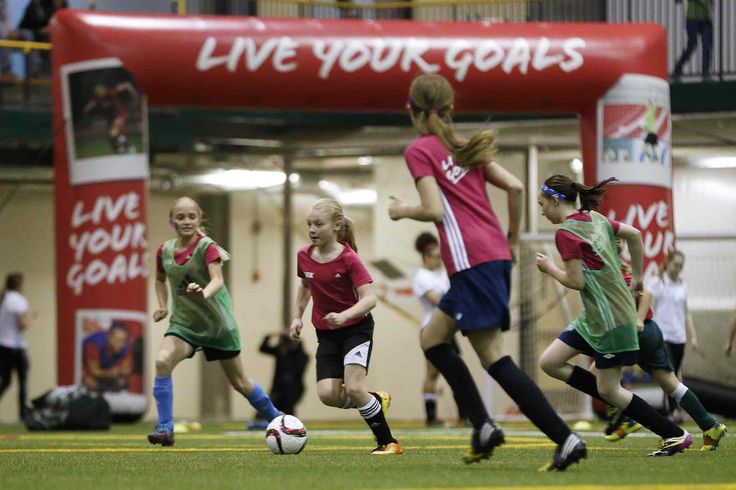 Female youth players take part in the FIFA Live Your Goals festival at the University of Manitoba on Monday. About 200 youngsters attended the clinic.