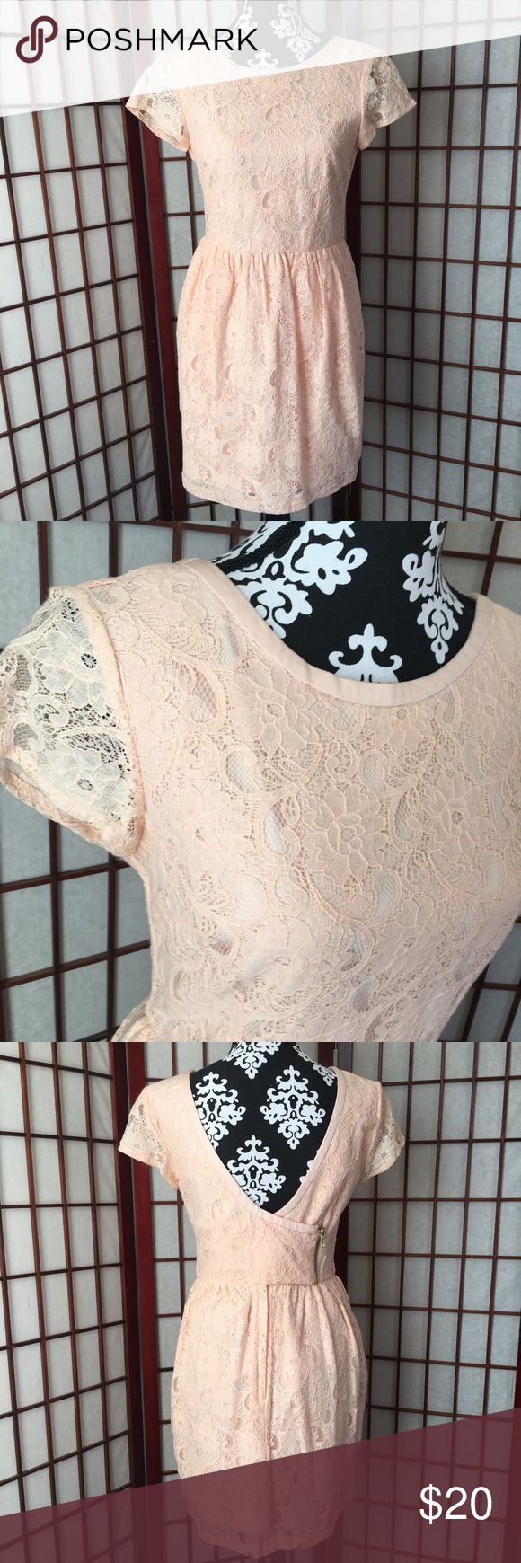 NWT H&M peach lace low back exposed zipper 8 NWT H&M peach lace dress low back with 2 zippers on the back with buttons from the conscious collection size 8 see measurements in pictures. Beautiful dress! H&M Dresses