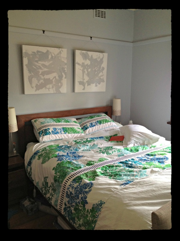 When Ling sent me the photo of her bedroom space I was struck by the story behind it. The two canvas prints on the wall were done by her 2 sons as a Mother Day present. They were 2 and 6 months old at the time and created them using left over paint from some sample pots.