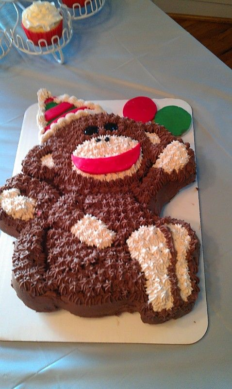 This is my version of a Sock Monkey cake. I used a Wilton pan, then made a few small changes. I made it for my grandson's first birthday party.