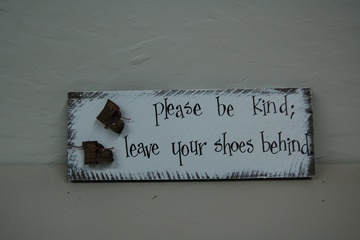 We have a little red sign with these words hanging in our entry. Leaving shoes at the door was a custom my wife picked up while living in Atlantic Canada.