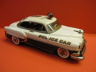 MARUSAN , MADE IN JAPAN , 1955 RARE JAPANESE TIN CHEVROLET POLICE CAR ALL LITHO TIN CAR , BATTERY OPERATED ALL ORIGINAL , MINT CONDITION EXCEPT 2 VERY SMALL FACTORY TOUCH UP NEAR ROOF LIGHT SIZE IS 28