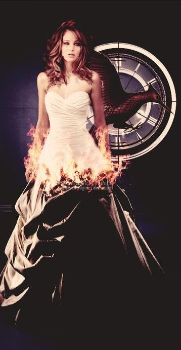 Girl on Fire / karen cox. Jennifer Lawrence ♥ Hunger Games V. Via @vanlisana. #gowns #elegant