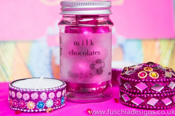 Stunning Asian wedding and celebration favours. Trinket favour pots and foil pink chocolate balls in a cute candy jar. From www.fuschiadesigns.co.uk.