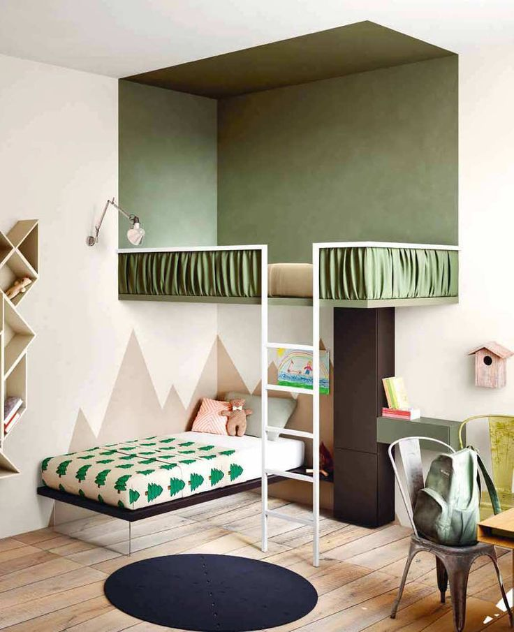 Floating loft bed for kids, zoned in using block colour. Love those accents of green!