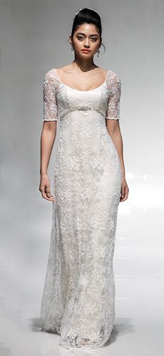So pretty in this simple lace-covered empire wedding dress by Emma Hunt