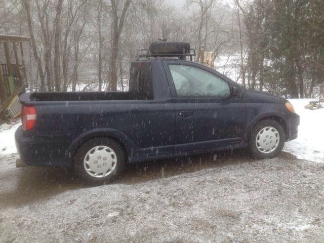Soooo someone in my town converted a 2000 toyota echo into a pickup. - Imgur