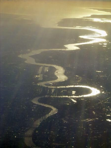 A view of the River Thames as it winds through London. You can see the loop of The Isle of Dogs and Canary Wharf, the Thames Barrier, then away towards the QEII bridge at Dartford where the river widens out and becomes the Thames Estuary.