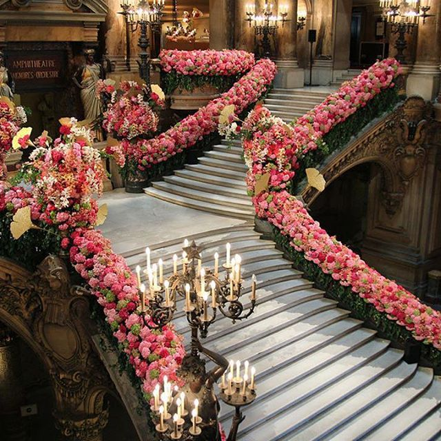 When in #Paris, @operadeparis is one of our top spots to visit and we're completely taken with this lush #floraldesign that gives the historic opera house that little bit of extra magic. Just imagine walking down these stairs in a #wedding dress! #luxury #floral #romantic   Photo credit: @wonderlusteurope