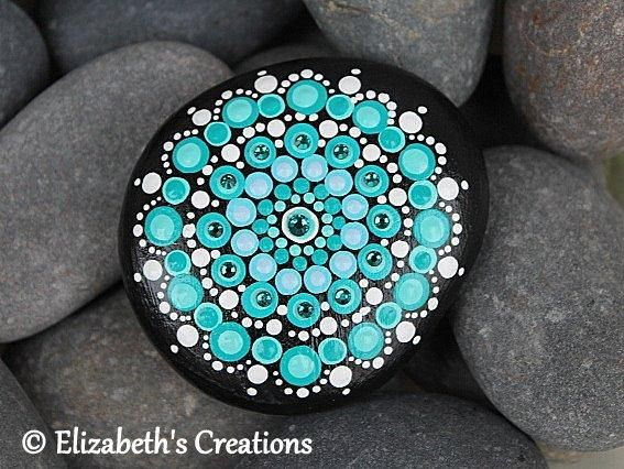 Beautiful hand painted Mandala Stone . This stone measures approximately 2.75 x 2.5 inches. The colors are very rich and vibrant as you can see and this design is made entirely from hand painted dots.... dot by dot! Shipping is done thru USPS. I ship priority so it is a fixed cost.