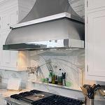 kitchens - marble spice shelf marble backsplash countertops white kitchen cabinets brushed nickel pot filler beadboard ceiling Viking Range