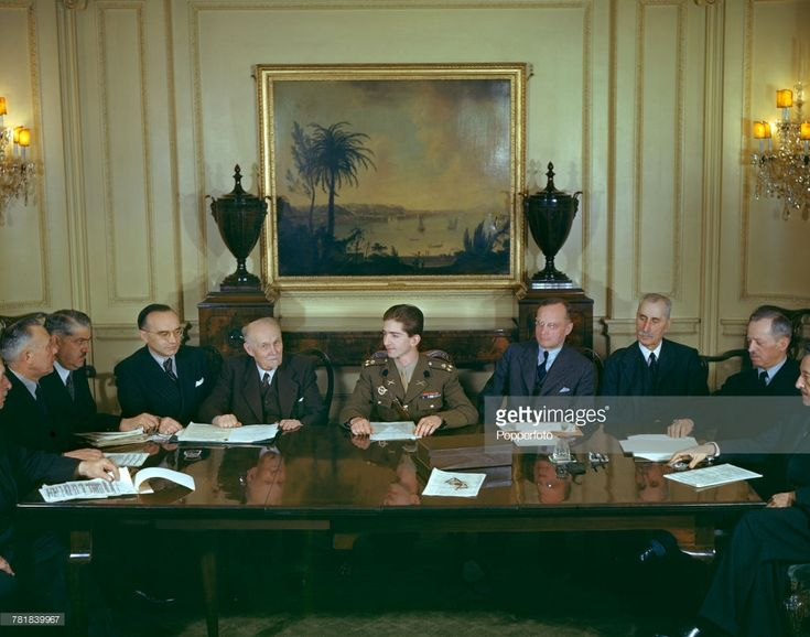 King Peter II of Yugoslavia (1923-1970) pictured seated in centre at a conference table with members of his cabinet government in exile in London in May 1943. King Peter II of Yugoslavia arrived in London after being driven in to exile from his homeland by Germany's invasion in 1941. (Photo by Popperfoto/Getty Images)