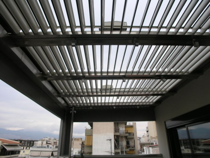 Aluminum waterproof shading system Glazetech GE in a house in New Philadelphia area in Athens. Here is the system in opened position.