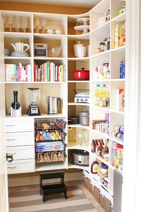 Walk-in pantry organization with a place for everything including appliances and entertaining dishes. Click for before & after