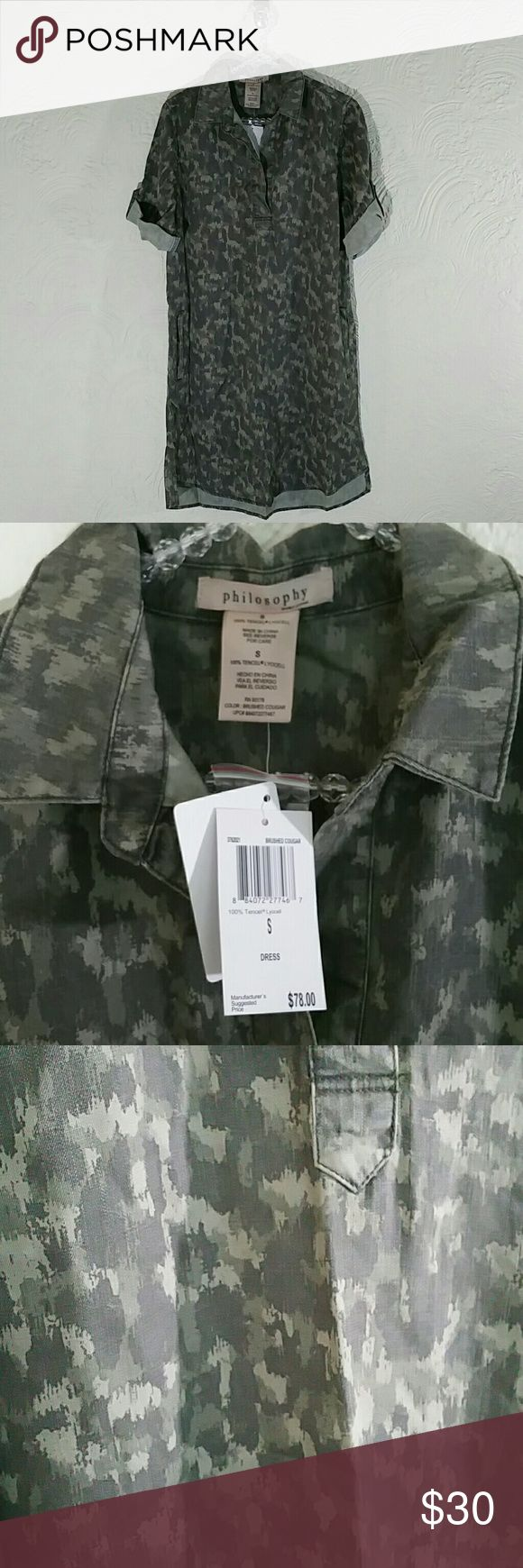 """Philosophy Brushed Cougar Camouflage Shirt Dress So stylish and on trend with its cuffed sleeves and side pockets! Never worn. NWT  Measurements are taken flat and are approximate  Pit to Pit 17.5""""  Length 28.5"""" front / 36"""" back  100116550sc 01Bb  NO TRADES   Ships fast from a smoke and pet free home. Philosophy Dresses High Low"""
