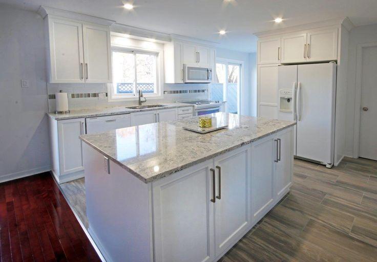 Crisp white cabinetry.  www.mrkitchens.ca