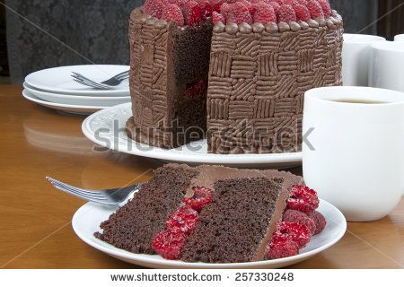 Homemade Chocolate Raspberry Cake with original design. Slice on a plate with wh…
