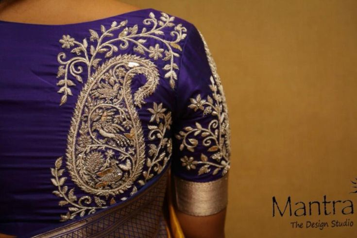 Stunning purplecolor designer blouse with floret lata design hand embroidery silver thread work. 25 December 2017