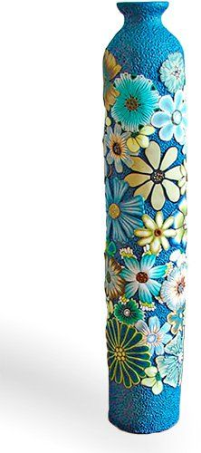 """Florida's Pamela Carman covers an18"""" tall vase with a garden of polymer flowers. She upcycles the containerby applying a base layer of solid-colorpolymerthat she textures. Over thatshe adds slices of canes (she must have a large stash) let [...]"""