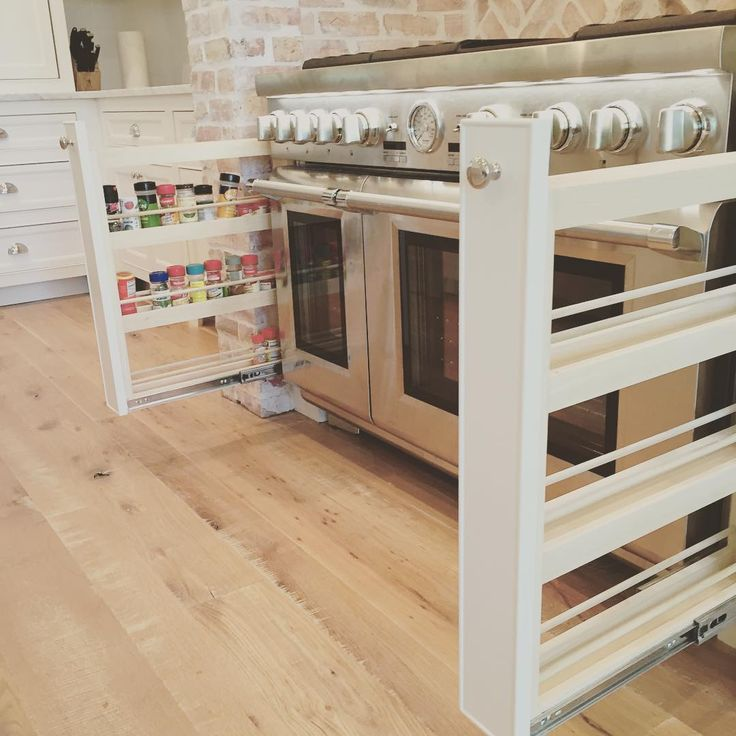Another kitchen fave are the spice pullouts beside the stove range! Love being able to have easy access while cooking. #coastal #farmhouse #kitchen