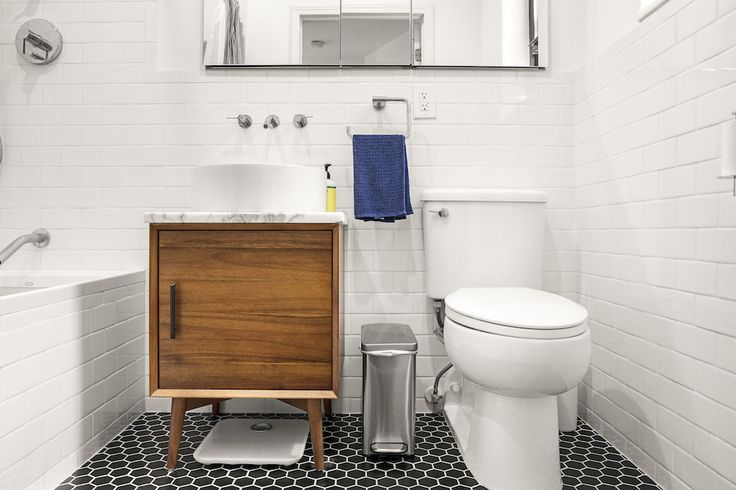 Wondering about this cool sink vanity? It's a West Elm side table moonlighting in the bath.