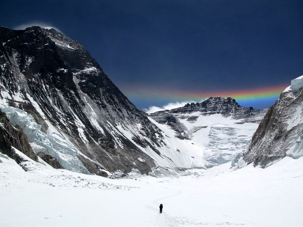Climber on his way to Camp 2 (6400m) on Mount Everest. He is in the large valley known as the Western Cwm, with the gigantic south west face of Everest on the left and Lhotse directly ahead (the 4th highest mountain in the world). There is a circumzenithal arc above Lhotse. Credit to Anselm Murphy