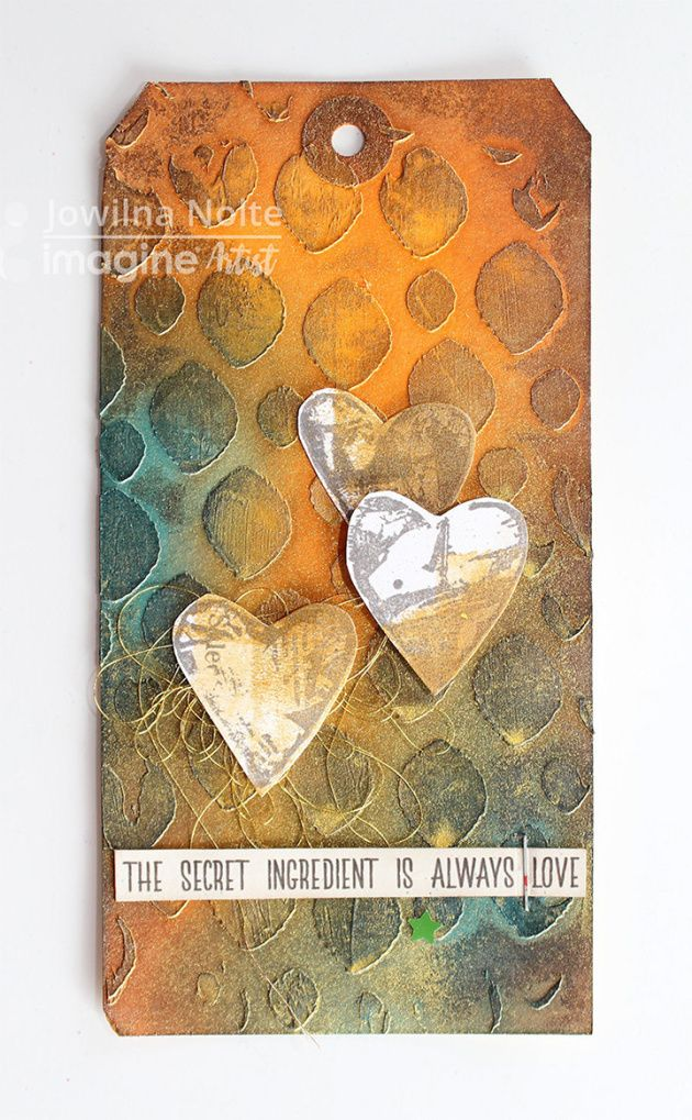 Jowilna Nolte makes The Secret Ingredient is Love Tag using StazOn ink. orange, blue, brown, texture, stencil, mixed media, shimmer.