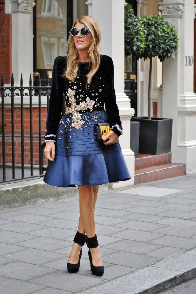Anna Dello Russo - her look is almost bizarre, but there's something alluring about the fashion -- perhaps a statement ensemble, like carrie b. I think she pulls it off.