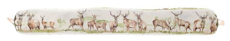 Moorland Stag Draught Excluder By Voyage Maison. The draught excluders measure approximately 95 cm wide by 13 cm with storage handle. The draught excluders are filled with scented lavender and natural wheat and have a printed 53% linen and 47% cotton fabric cover.