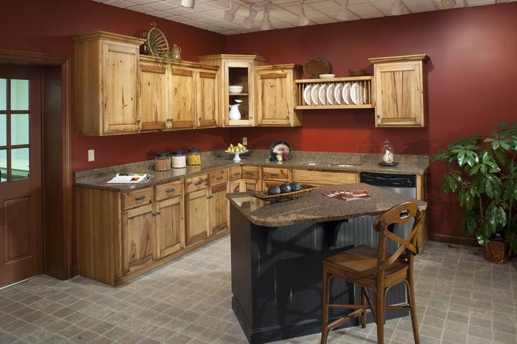 Hickory Cabinets with Black Harware Red walls - very similar to our kitchen
