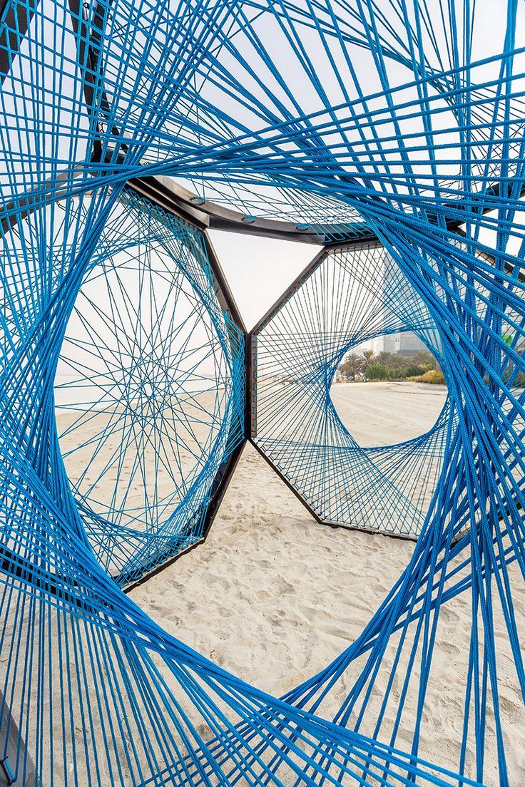 aljoud lootah weaves sculptural seaside installation using emirati fishing techniques