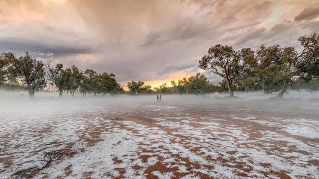 <p>Residents of the remote Northern Territory town of Alice Springs were shocked to see its iconic red dirt coated in white hailstones, after storms hit after 4pm yesterday. </p> <p>(Caama Alice Springs / Steve Strike)</p>